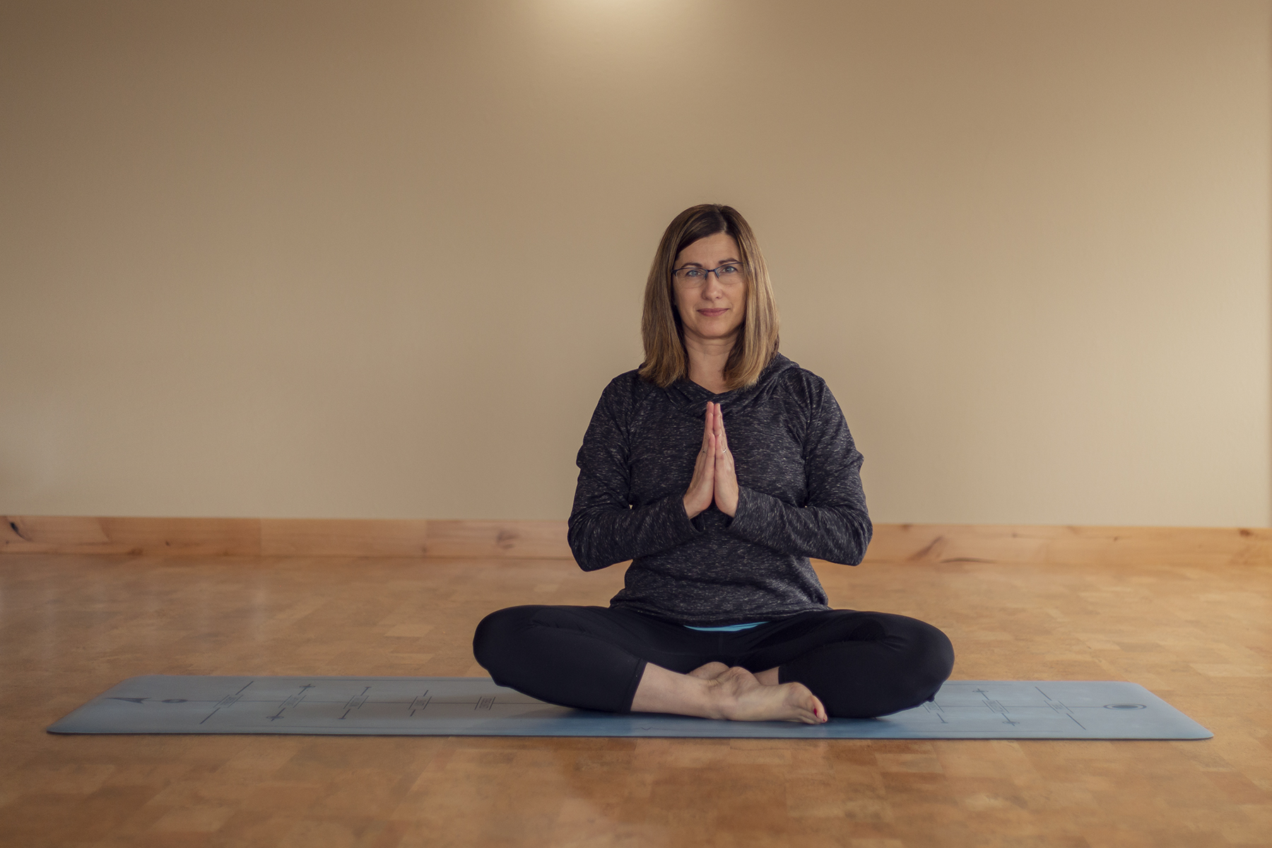 Melissa in a yoga pose, photo credit noxbox photography